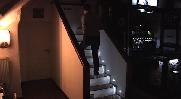 Each Step In The Stairway Lights Up With LED Motion Sensor Lights As Person  Ascends
